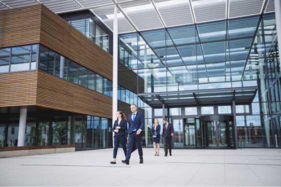 business-people-walking-outside-office-building